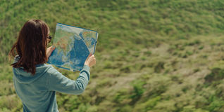 Traveler woman with a map outdoor Stock Images