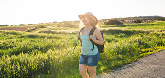Traveler woman on nature. Concept of travel, hitch-hiking and vacation. stock image