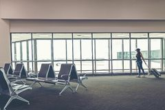 Traveler woman plan and backpack see the airplane at the airport glass window, girl tourist hold bag and waiting near luggage in h Royalty Free Stock Photography