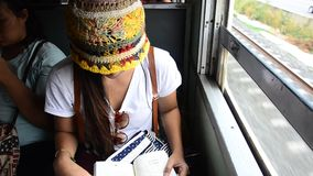Traveler woman reading book on Railway Train  in Ayutthaya Thailand stock video
