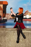 Traveler woman red hair girl with camera old town Gdansk Royalty Free Stock Images