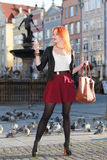 Traveler woman red hair girl with smart phone old town Gdansk Stock Photography
