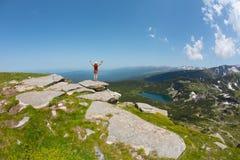 Traveler woman relaxing near the mountain lake Stock Photo