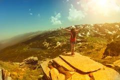 Traveler woman relaxing near the mountain lake Royalty Free Stock Image