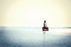 Traveler woman resting in front the spectacular ocean stock photos