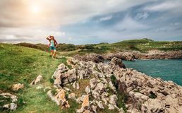Traveler woman on the sea coast Royalty Free Stock Image