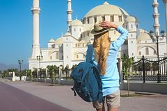 Traveler woman by the Sheikh Zayed Grand Mosque in Fujairah, Uni. Young traveler woman by the Sheikh Zayed Grand Mosque in Fujairah, United Arab Emirates stock images