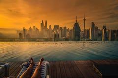 Traveler woman sleep on the sun bed near swimming pool Stock Photography