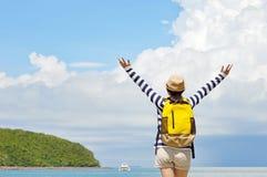 Traveler woman standing  and enjoying a beautifu Stock Photography