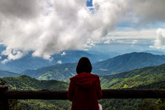 Traveler woman standing looking view of mountain Stock Photo