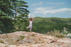 Traveler woman standing in yoga pose of tree Royalty Free Stock Photography
