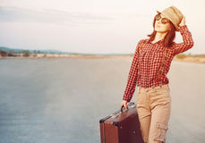 Traveler woman with suitcase Royalty Free Stock Photo