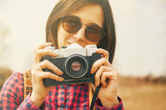 Traveler woman takes photographs with vintage photo camera Royalty Free Stock Image
