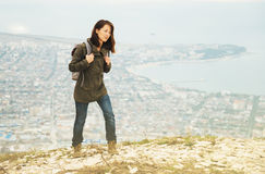 Traveler woman trekking in highlands over the city Royalty Free Stock Photo