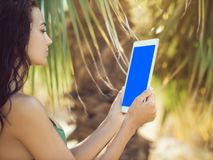 Traveler woman using tablet computer. Royalty Free Stock Image