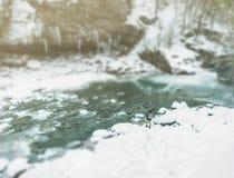 Traveler walking in winter, tilt-shift effect. Traveler woman walking along the river bank in winter, image with tilt-shift effect royalty free stock photos