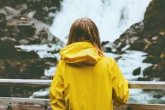 Traveler woman walking outdoor Travel Lifestyle. Wanderlust concept adventure active vacations girl looking at waterfall royalty free stock photo