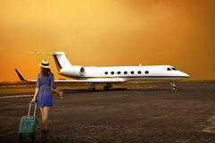 Traveler Woman Walking Into Private Jet Royalty Free Stock Images