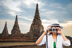 Traveler women covering her face with the camera Stock Photos