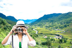Traveler women taking photo with old fashioned camera Stock Image