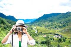 Traveler Women Taking Photo With Old Fashioned Camera Stock Image
