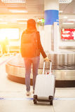 Traveler women waiting bag in the mpty baggage claim Stock Images