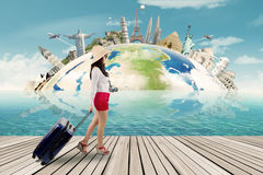 Traveler and the world monuments background Royalty Free Stock Images