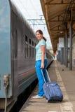 Traveler young girl at station Stock Photos