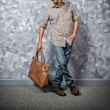 Traveler young man asian with leather bag. stock images