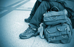 Travelers. Sitting underground, close-up legs Stock Photography