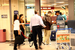 Travelers at Airport. Travelers at the Changi Airport, Singapore. Slow speed motion blur Royalty Free Stock Image