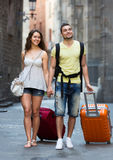 Travelers with a backpack and suitcases Royalty Free Stock Images