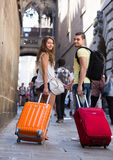 Travelers with baggage in the street Stock Photography