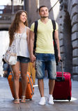 Travelers with baggage in the street Stock Photo