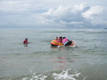 Travelers on the beach in Rayong Province. Royalty Free Stock Image