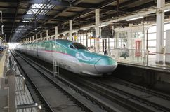 Travelers board Shinkansen Hayabusa train Royalty Free Stock Image