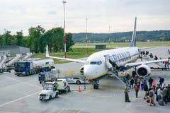 Travelers boarding Ryanair airplane stock photos