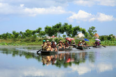 Travelers on boats to visit rice fields on river Stock Images