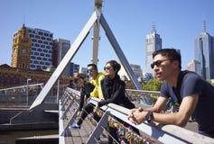 Travelers on bridge Royalty Free Stock Image