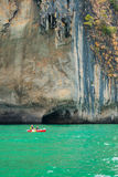 Travelers canoeing in the sea Royalty Free Stock Images