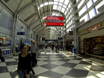 Travelers at Chicago OHare airport Royalty Free Stock Images