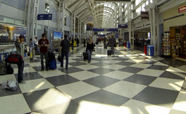 Travelers at Chicago OHare airport. After flight tower sabotage Stock Photos