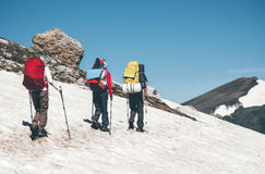 Travelers climbing in mountains with backpack Royalty Free Stock Photos