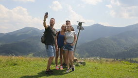 Travelers do selfie in the mountains next to the signpost.  stock video footage