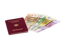 Travelers Document. German passport with European bank notes - isolated on white royalty free stock image