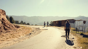 Travelers on a dusty mountain road Royalty Free Stock Photos