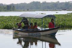 Travelers. Enjoy the water by renting a fishing boat Boyolali, Central Java, Indonesia Stock Photo