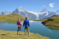 Travelers enjoying Alpine panorama Royalty Free Stock Photos