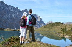 Travelers enjoying alpine view Royalty Free Stock Photo