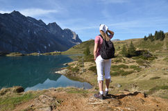 Travelers enjoying alpine view Royalty Free Stock Images